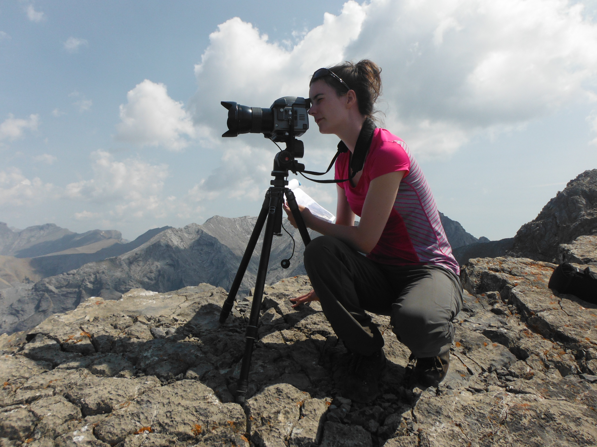 Tanya Taggart-Hodge conducting third views on Mt.Grotto, which will enable a comparative analysis of the Bow River from three temporal sets of photographs