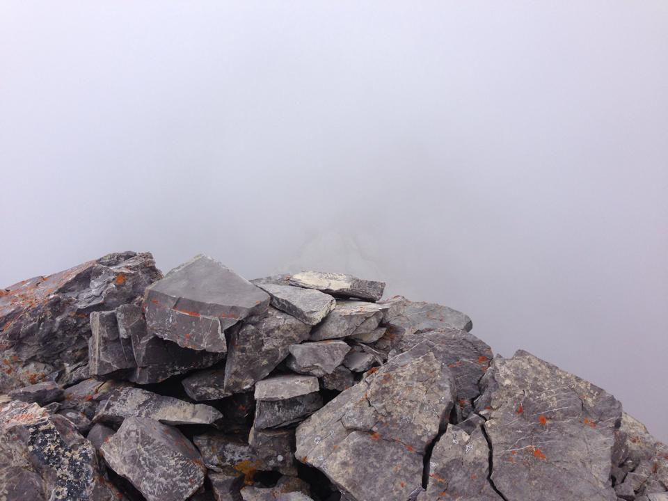 Waiting for the fog to clear on Fisher Peak.  Photo credit:  Rick Arthur