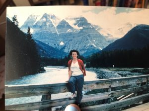 Janet sitting in front of Mount Robson